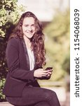 cheerful female intern using...   Shutterstock . vector #1154068039