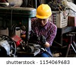 young asian engineer woman ... | Shutterstock . vector #1154069683