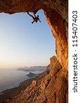 rock climber at sunset ... | Shutterstock . vector #115407403