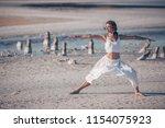 attractive woman doing yoga in... | Shutterstock . vector #1154075923