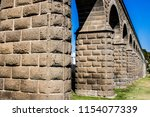 close up of the arches of a... | Shutterstock . vector #1154077339