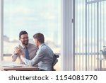 smiling business people at the... | Shutterstock . vector #1154081770
