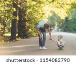 father and son with a... | Shutterstock . vector #1154082790