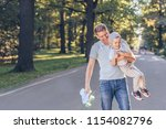 happy family with a skateboard... | Shutterstock . vector #1154082796