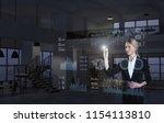 a businesswoman using diagrams... | Shutterstock . vector #1154113810