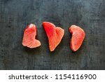 raw tuna fish steaks on vintage ... | Shutterstock . vector #1154116900