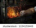 real hot metal oven grill in a... | Shutterstock . vector #1154153443