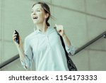 excited carefree female intern...   Shutterstock . vector #1154173333