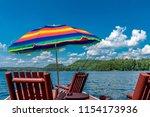 under a brilliant blue summer... | Shutterstock . vector #1154173936