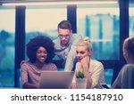 multiethnic startup business... | Shutterstock . vector #1154187910