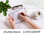 top view female hand writes... | Shutterstock . vector #1154218699