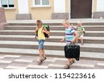 happy pupil children go back to ...   Shutterstock . vector #1154223616