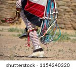 high stepping male native... | Shutterstock . vector #1154240320