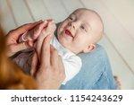 newborn child lies on mother... | Shutterstock . vector #1154243629