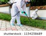 exterminators outdoors in work... | Shutterstock . vector #1154258689
