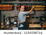 happy young female bartender... | Shutterstock . vector #1154258716