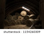 bales of hay being stored in an ... | Shutterstock . vector #1154260309