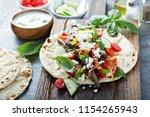 flatbread with beef  feta...   Shutterstock . vector #1154265943