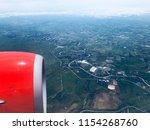 airplane flight. wing of an... | Shutterstock . vector #1154268760