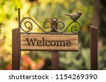 welcome vintage wooden sign on... | Shutterstock . vector #1154269390