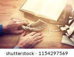 jewish man hands next to prayer ...   Shutterstock . vector #1154297569