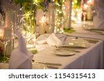 wedding banquet or gala dinner... | Shutterstock . vector #1154315413