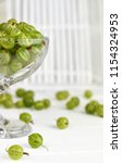 green delicious gooseberry on... | Shutterstock . vector #1154324953