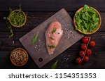 board with raw chicken fillet...   Shutterstock . vector #1154351353