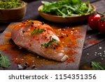 board with raw chicken fillet...   Shutterstock . vector #1154351356