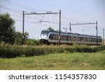 local commuter train on the... | Shutterstock . vector #1154357830