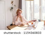 hispanic woman using digital... | Shutterstock . vector #1154360833