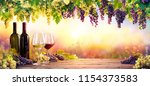 bottles and wineglasses with... | Shutterstock . vector #1154373583
