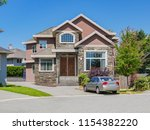 luxury family house with a car... | Shutterstock . vector #1154382220