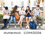 portrait of teenage frineds... | Shutterstock . vector #1154420206