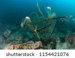 an abandoned ghost fishing net... | Shutterstock . vector #1154421076