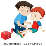 man helping a boy with a injury ... | Shutterstock .eps vector #1154424589
