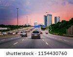 night traffic. cars on highway... | Shutterstock . vector #1154430760