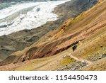 hikers along a high altitude... | Shutterstock . vector #1154450473
