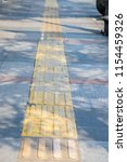 tactile paving  a system of... | Shutterstock . vector #1154459326