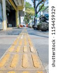 tactile paving  a system of... | Shutterstock . vector #1154459329