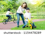 asian mother and kids having...   Shutterstock . vector #1154478289