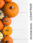 many orange pumpkins on white... | Shutterstock . vector #1154479039