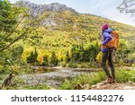 woman hiker hiking looking at... | Shutterstock . vector #1154482276