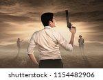 rear view of man with guns... | Shutterstock . vector #1154482906