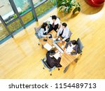 aerial view of a team of asian...   Shutterstock . vector #1154489713