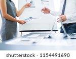 asian business adviser meeting...   Shutterstock . vector #1154491690