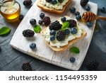 fresh sweet blackberry ... | Shutterstock . vector #1154495359