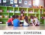 woman teacher in classroom... | Shutterstock . vector #1154510566