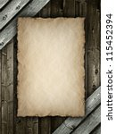Paper sheet on wood background - stock photo