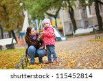 mother and daughter at the... | Shutterstock . vector #115452814